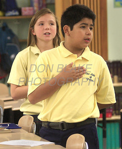 Former St. Paul student Paul Rodriguez and Emily Gray recite the pledge of allegiance during homeroom in Ms. Foran 6th grade class at Our Lady of Fatima School, Thursday, August 25, 2011. The Dialog/Don Blake