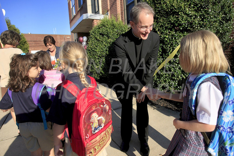 Fr. Charles Dillingham greets students as they enter school during the first day of school at All Saints Catholic School, Elsmere, Del., Tuesday, August 30, 2011. The Dialog/Don Blake