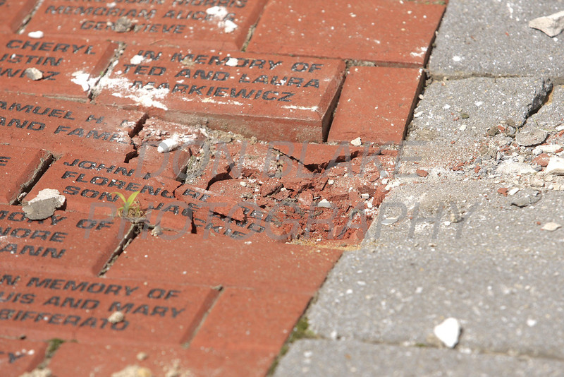 Large stones that fell from the top of St. Thomas the Apostle Church in Wilmington, Del, damaging part of the memorial brick walkway during the magnitude 5.8 earthquake that shook the east coast, Tuesday, August 23, 2011. The Dialog/Don Blake