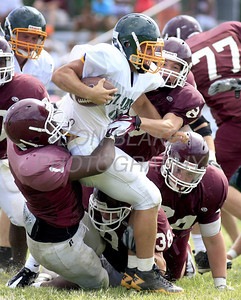 St. Mark's ball carrier is meant by a gang for Concord defenders as St. Mark's hosted Concord in their first scrimmage in preparation for the start of the high school football season. The Dialog/Don Blake