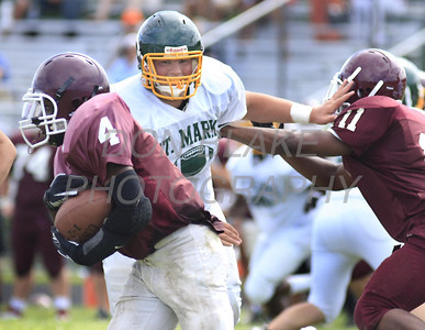 St. Mark's lineman get off a block to go after Concord's ball carrier as St. Mark's hosted Concord in their first scrimmage in preparation for the start of the high school football season. The Dialog/Don Blake