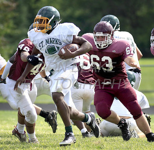 St. Mark's ball carrier rans the ball as St. Mark's hosted Concord in their first scrimmage in preparation for the start of the high school football season. The Dialog/Don Blake