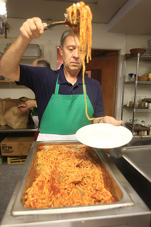 John Nawrocki plates the spaghetti in the kitchen of the Knights of Columbus Hall during their spaghetti dinner. www.DonBlakePhotography.com