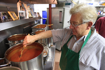 Herb Casalena mixes the spaghetti sauce in the kitchen of the Knights of Columbus Hall during their spaghetti dinner. www.DonBlakePhotography.com