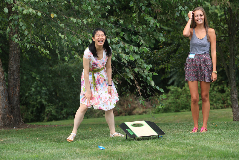 Winnie Wei (left) an exchange student from China and 11th grade Padua Academy student Sarah Lott play a beanbag game during a picnic to introduce American students to Chinese students who will be studying at Padua and St. Elizabeth this year. photo/www.DonBlakePhotography.com