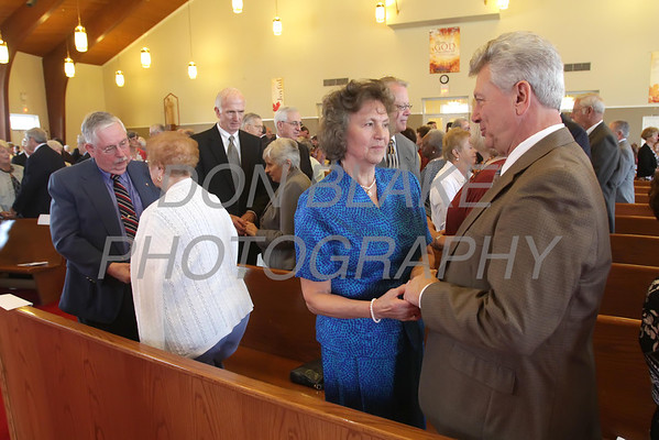 Pietro and Giovanna Anoia who have been married for 50 years renew their vows during the annual Wedding Anniversary Mass at St. John the Beloved Church, September 15, 2013. wwwDonBlakePhotography.com
