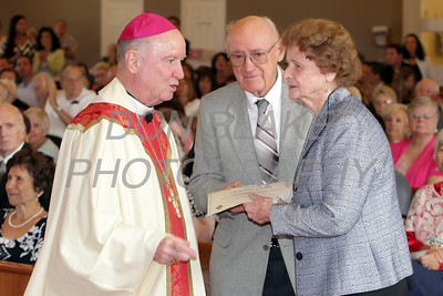 Louis and Victoria Twardowski who have been married for 70 years shake hands with Bishop Malooly during the annual Wedding Anniversary Mass at St. John the Beloved Church, September 15, 2013. wwwDonBlakePhotography.com