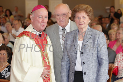 Louis and Victoria Twardowski who have been married for 70 years with Bishop Malooly during the annual Wedding Anniversary Mass at St. John the Beloved Church, September 15, 2013. wwwDonBlakePhotography.com