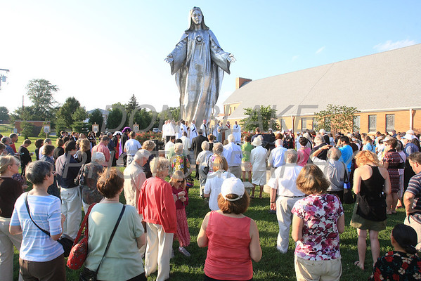 Faithful from around the Diocese pray the rosary during Diocesan Marian Pilgrimage at the Shrine of Our Lady of Peace at Holy Spirit Church, Saturday, September 22, 2012. photo/www.DonBlakePhotography.com