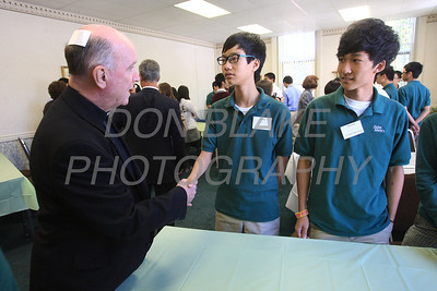 Bishop Malooly speaks with Lucky Xia 11th grade (left) and Edward Zhang 12 grade two of the foreign students that are attending St. Mark's High School during a lunch with all the foreign students, Monday, September 24, 2012. photo/www.DonBlakePhotography.com