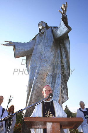 Bishop Malooly prays the rosary at the foot of the Our Lady of Peace statue during Diocesan Marian Pilgrimage at the Shrine of Our Lady of Peace at Holy Spirit Church, Saturday, September 22, 2012. photo/www.DonBlakePhotography.com