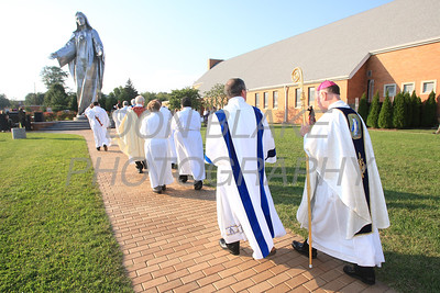 Bishop Malooly processes to the foot of the Our Lady of Peace statue during Diocesan Marian Pilgrimage at the Shrine of Our Lady of Peace at Holy Spirit Church, Saturday, September 22, 2012. photo/www.DonBlakePhotography.com