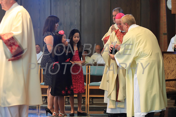 Michael Stankewicz's family presents Bishop Malooly with the gifts during the Ordination of Deacon at St. Mary of the Assumption, Saturday, September 15, 2012. www.DonBlakePhotography.com