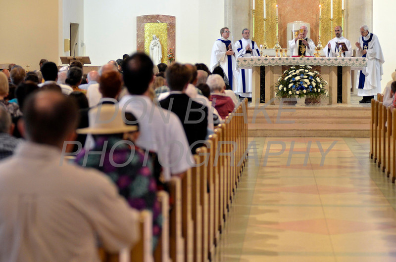 Faithful from around the Diocese pray as Bishop Malooly blesses the host during Diocesan Marian Pilgrimage at the Shrine of Our Lady of Peace at Holy Spirit Church, Saturday, September 22, 2012. photo/www.DonBlakePhotography.com
