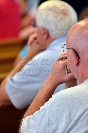 Faithful from around the Diocese pray during Diocesan Marian Pilgrimage at the Shrine of Our Lady of Peace at Holy Spirit Church, Saturday, September 22, 2012. photo/www.DonBlakePhotography.com