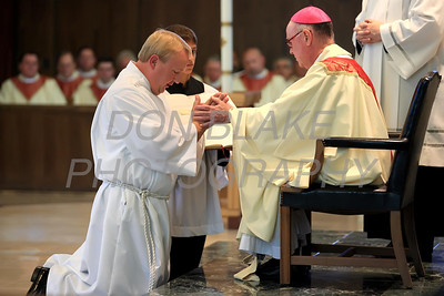 Michael Stankewicz kneels before Bishop Malooly during the Ordination of Deacon at St. Mary of the Assumption, Saturday, September 15, 2012. www.DonBlakePhotography.com