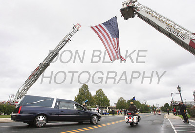 The hearse is escorted from the Chase Center after the funeral of New Castle County Police, Lt. Joseph Szczerba at the Chase Center on the Riverfront in Wilmington, Del., Friday, September 23, 2011. The Dialog/Don Blake