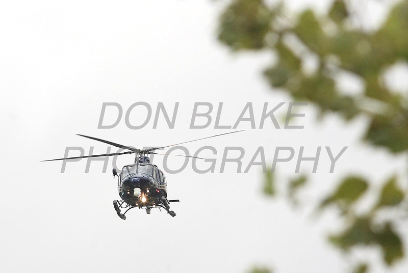 Helicopters fly over during the funeral of New Castle County Police, Lt. Joseph Szczerba at the Chase Center on the Riverfront in Wilmington, Del., Friday, September 23, 2011. The Dialog/Don Blake