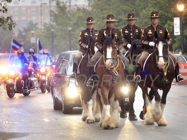 Mounted New Castle County Police escort the hearse on its arrival during the funeral of New Castle County Police, Lt. Joseph Szczerba at the Chase Center on the Riverfront in Wilmington, Del., Friday, September 23, 2011. The Dialog/Don Blake