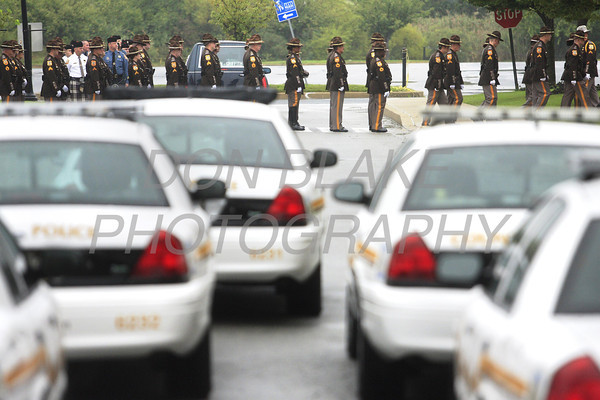 New Castle County Police wait to enter the Chase Center during the funeral of New Castle County Police, Lt. Joseph Szczerba at the Chase Center on the Riverfront in Wilmington, Del., Friday, September 23, 2011. The Dialog/Don Blake