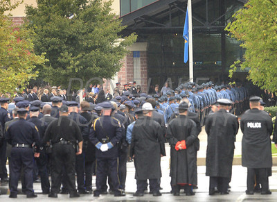 Police from around the state wait to enter the Chase Center during the funeral of New Castle County Police, Lt. Joseph Szczerba at the Chase Center on the Riverfront in Wilmington, Del., Friday, September 23, 2011. The Dialog/Don Blake