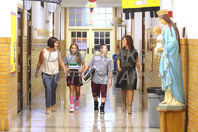St. Elizabeth Elementary School Principles Dana DelleDonne (left) and Tina Wecht walk with 7th grade students Madison Martinez and Thomas Maddams in the hallway at St. Elizabeth Elementary School. wwwDonBlakePhotography.com