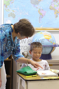 3rd grade teacher Karen Hnatowski helps student Paul McLaughlin during class at St. Elizabeth Elementary School. wwwDonBlakePhotography.com