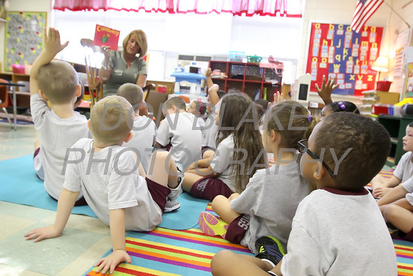 Kindergarten students gather around teacher Colleen Craighton for story time at St. Elizabeth Elementary School. wwwDonBlakePhotography.com