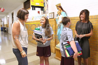 St. Elizabeth Elementary School Principles Dana DelleDonne (left) and Tina Wecht talk to 7th grade students Madison Martinez and Thomas Maddams in the hallway at St. Elizabeth Elementary School. wwwDonBlakePhotography.com