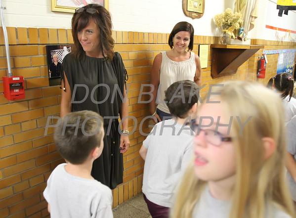St. Elizabeth Elementary School Principles Tina Wecht (left) and Dana DelleDonne greet students in the hallway at St. Elizabeth Elementary School. wwwDonBlakePhotography.com
