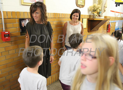 St. Elizabeth Elementary School Principles Tina Wecht (left) and Dana DelleDonne greet students in the hallway at St. Elizabeth Elementary School. wwwDonBlakePhotography.com