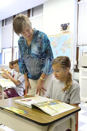 3rd grade teacher Karen Hnatowski helps student Gianna DiStefano during class at St. Elizabeth Elementary School. wwwDonBlakePhotography.com