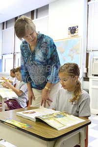 3rd grade teacher Karen Hnatowski helps student Gianna DiStefano during class at St. Elizabeth Elementary School. wwwDonBlakePhotography.com