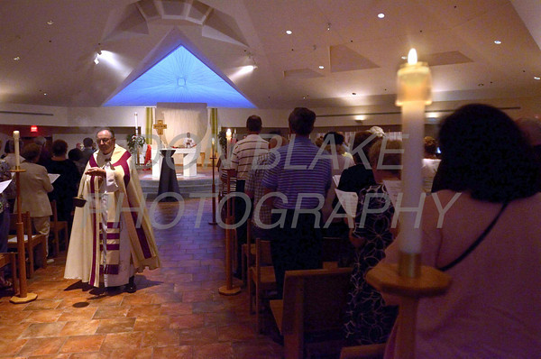 Fr. Arthur Fiore uses an incensor during a 9/11 10th anniversary candlelight Vespers at Holy Angels Church, Sunday, September 11, 2011. The Dialog/Don Blake