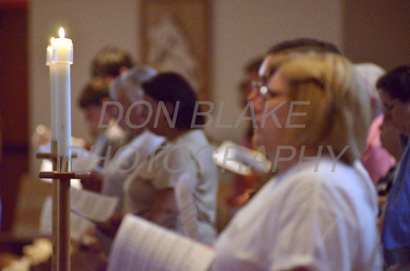 The faithful pray during a 9/11 10th anniversary candlelight Vespers at Holy Angels Church, Sunday, September 11, 2011. The Dialog/Don Blake