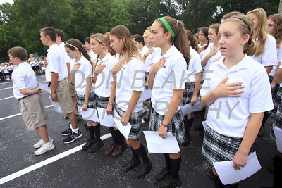 8th grade students along with the entire student body at Immaculate Heart of Mary School gather at 8:46 to recite the pledge allegiance and pray during a solemn ceremony to commemorate the 10th anniversary of 9/11 on Friday, September 9, 2011. The Dialog/Don Blake