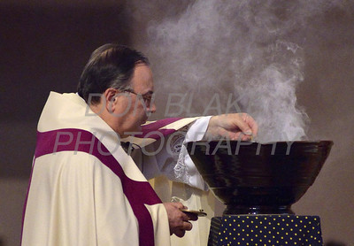 Fr. Arthur Fiore lights the incense during a 9/11 10th anniversary candlelight Vespers at Holy Angels Church, Sunday, September 11, 2011. The Dialog/Don Blake