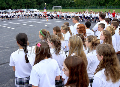 The entire student body at Immaculate Heart of Mary School gather at 8:46 to recite the pledge allegiance and pray during a solemn ceremony to commemorate the 10th anniversary of 9/11 on Friday, September 9, 2011. The Dialog/Don Blake