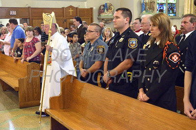 Bishop Malooly processes to alter with police and fire  personnel present for a 9/11 10th anniversary mass at St. Hedwig Church, Sunday, September 11, 2011. The Dialog/Don Blake