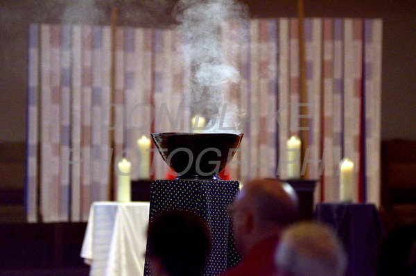 Incense full the air in front of the banners with the names of the victims of the terrorist attacks during a 9/11 10th anniversary candlelight Vespers at Holy Angels Church, Sunday, September 11, 2011. The Dialog/Don Blake
