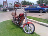 "(July 17th, 2010) ""Chopper""<br /> <br /> A customized Chopper parked outside the Papa's BBQ at Gulfgate. One can only hope that the owner is a lawyer type in suits and glasses.<br /> <br /> Check out the dragon pipes too.<br /> <br /> <br />  <a href=""http://theeastenders.wordpress.com/2010/07/17/dispatch-from-the-phone-photo-of-the-day-chopper/"">http://theeastenders.wordpress.com/2010/07/17/dispatch-from-the-phone-photo-of-the-day-chopper/</a>"