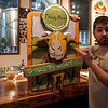 "Jake Maddux, Beer Evangelist at Thirsty Planet Brewery, shows off a new 3D sign advertizing their ""Thirsty Goat Amber""."