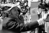 Prime Minister Pierre Trudeau shakes hands with the festive crowd that greeted him upon his arrival in Mexico City, Jan. 23, 1976. The Prime Minister is wearing a hat from the Mexican Ministry of Public Works as the Mexican Flag flies in the background. (CP PHOTO/ Fred Chartrand)