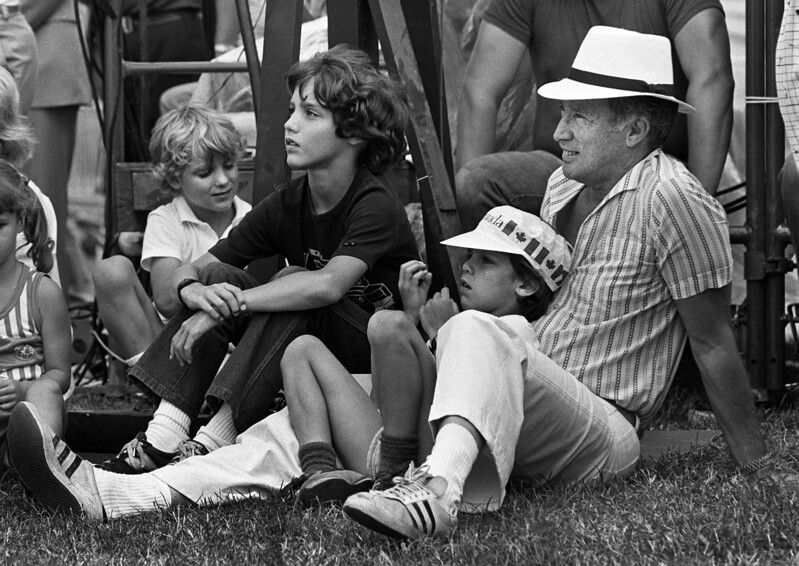 Prime Minister Pierre Trudeau  took  his sons to watch the official opening Canada Day ceremonies on Parliament Hill July 1, 1983 in Ottawa. Trudeau was an onlooker for the show, wearing a Panama hat and sneakers along with his three sons Alexandre (Sacha) , Justin and Michel. (CP photo/ Fred Chartrand)