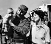 Margaret Trudeau smiles as Cuban President Fidel Castro holds her youngest son Michel after the Trudeaus arrived in Havana, Cuba, Jan.26, 1976. (CP PHOTO/Fred Chartrand)