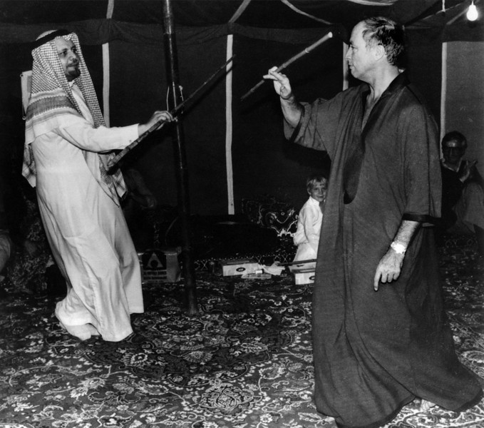Pierre Eliott Trudeau is shown in a November 19, 1980 photo dancing with Shiek Yamani of Saudi Arabia during a tour of Arab nations. (CP Photo Archive/ Fred Chartrand)