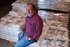 Mike Doguet, general manager at Doguet's Rice Milling Company in Beaumont, Texas, sits on stacked bags of rice in the warehouse.<br /> Photo/Scott Eslinger  -  ©2013 Eslinger Photographics