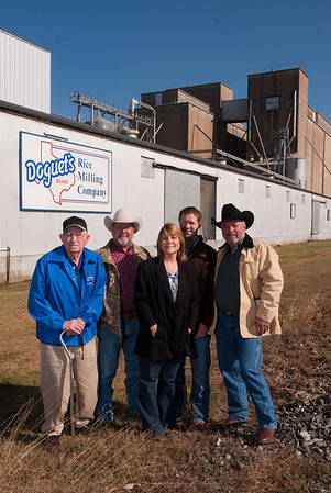 Several generations of the Doguet family pose for a photograph at Doguet's Rice Milling Company in Beaumont on December 10, 2013. Left to right, Darby Doguet, who is retired and started the company, Darby's son and daughter, Mike Doguet, general manager, and Debbie Robbins, President, Debbie's son, Greg Devillier, vice president, and Debbie's husband, Kevin Robbins, owner.<br /> Photo/Scott Eslinger  -  ©2013 Eslinger Photographics