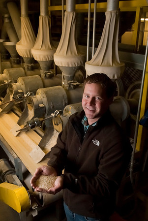 Greg Devillier, vice president of Doguet's Rice Milling Company in Beaumont, Texas, holds a handful of rice fresh out of the mill.<br /> Photo/Scott Eslinger  -  ©2013 Eslinger Photographics
