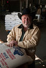 Kevin Robbins, an owner of Doguet's Rice Milling Company in Beaumont, Texas, stands in the packaging area of the rice mill.<br /> Photo/Scott Eslinger  -  ©2013 Eslinger Photographics